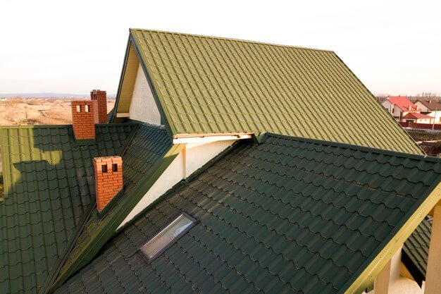 green metal shingled house roof